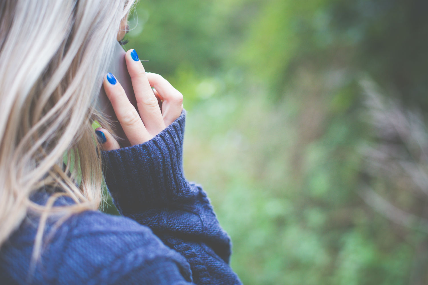 girl on mobile phone calling for help